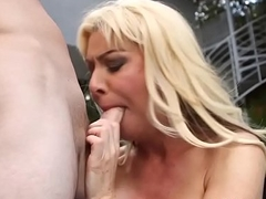 Busty cougar beauty gives scruffy head