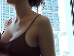 Amazing blowjob in a hotel room window