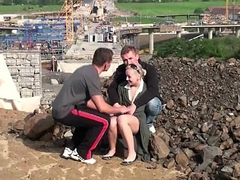 Youthful cute blonde teen girl PUBLIC threesome at a construction site
